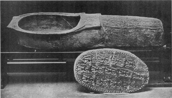 SLIPPER-SHAPED COFFIN MADE OF GLAZED EARTHENWARE