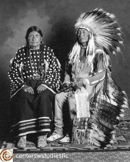 """""""Buckskin Charley and Wife Emma,"""" a portrait photograph taken by Pennington Studios c.1930.    """"Chief Buckskin Charley (1840–1936), whose Ute name was Sapiah, was the preeminent chief of the Muache band of the Southern Ute Tribe beginning around 1870. The name Buckskin Charley may have been given to him by some Buffalo Soldiers who saw him tanning hides. Later in life he was also referred to as Charles Buck. He married Te-Wee, also known as To-Wee (Emma Naylor Buck). They had two sons: Julian and Antonio Buck. Throughout his long tenure as chief of the Southern Ute Tribe, Buckskin Charley traveled to Washington, DC, numerous times, meeting seven US presidents. He was presented the Rutherford Hayes Peace Medal by President Benjamin Harrison in 1890."""""""